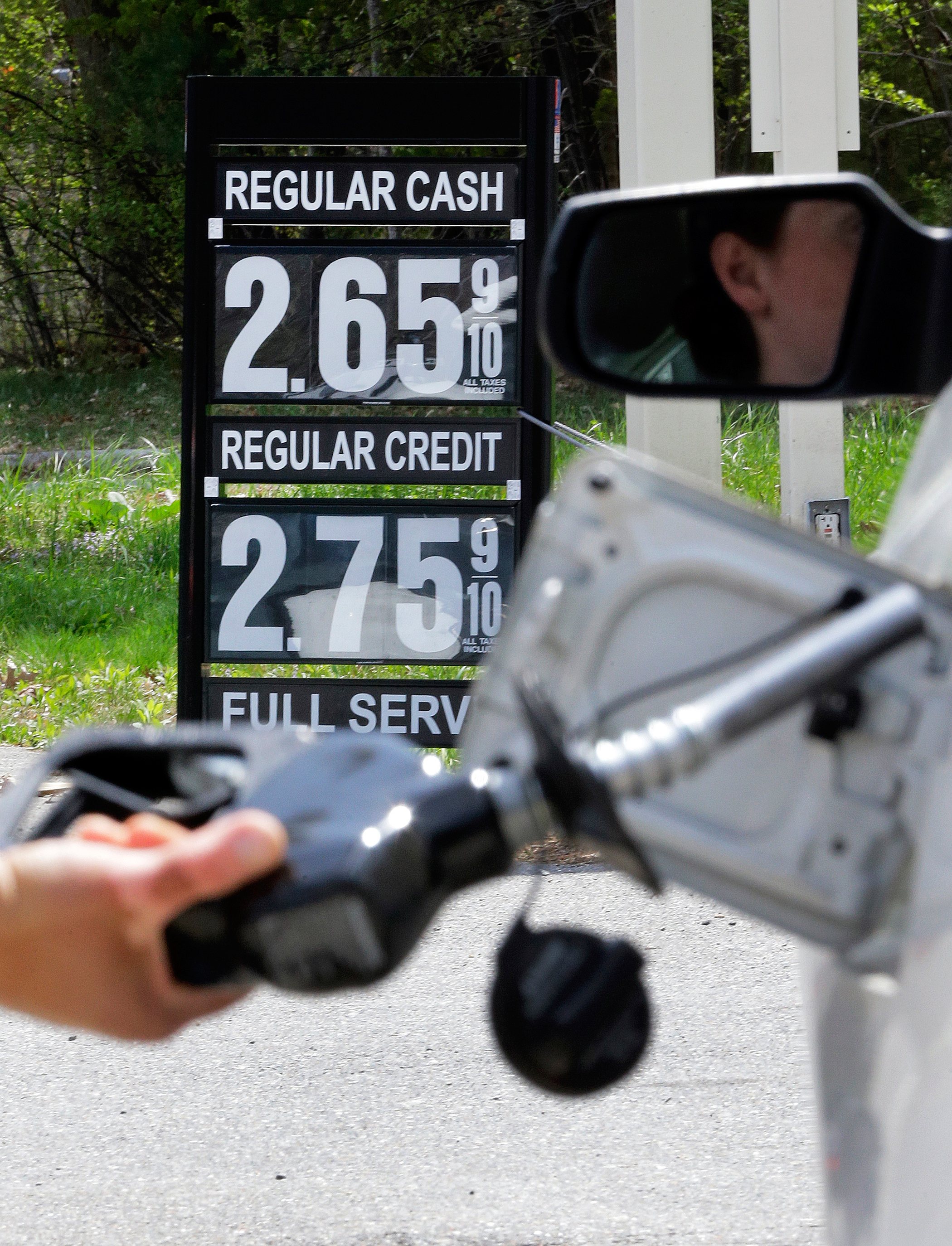 Gas station attendant pumping gas in Andover, Mass., May 8, 2015.