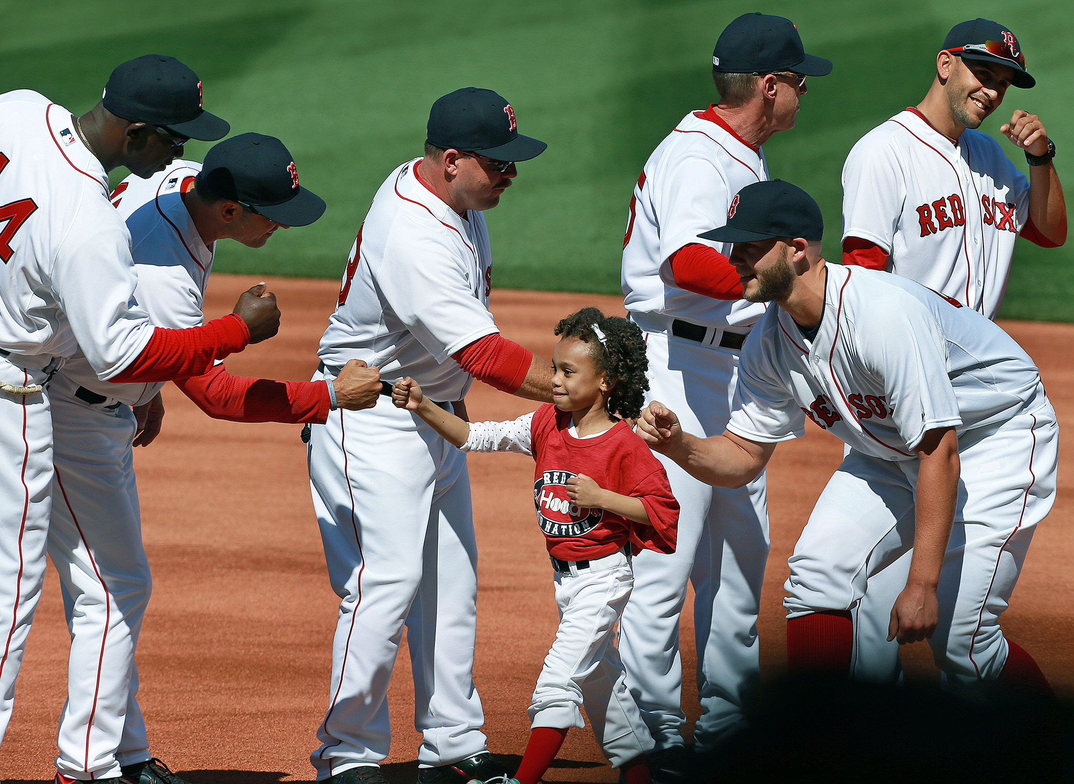 As part of a season-long program titled  Calling All Kids , the players of the Boston Red Sox were accompanied by children during pre-game introductions.