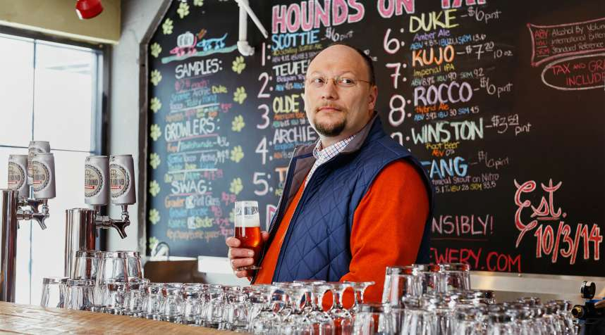 Beer Hound Brewery brew master and owner Kenny Thacker is seen behind the bar at the Beer Hound Brewery in Culpeper, VA on Sunday, February 22, 2015.