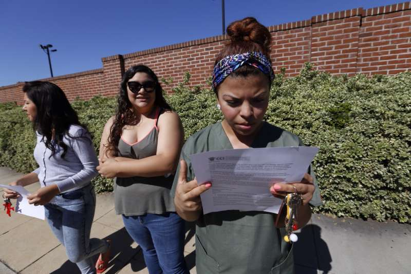 Ruby Maldanado, 20, a Medical Assistant student checks a note handed out to students that have been turned away at the gate to Everest College on April 27, 2015 in Alhambra, California. Corinthian Colleges Inc., a Santa Ana company that was once one of the nation's largest for-profit college chains, announced that it would be shutting down its remaining two dozen schools effective - a move that leaves 16,000 students scrambling for alternatives.