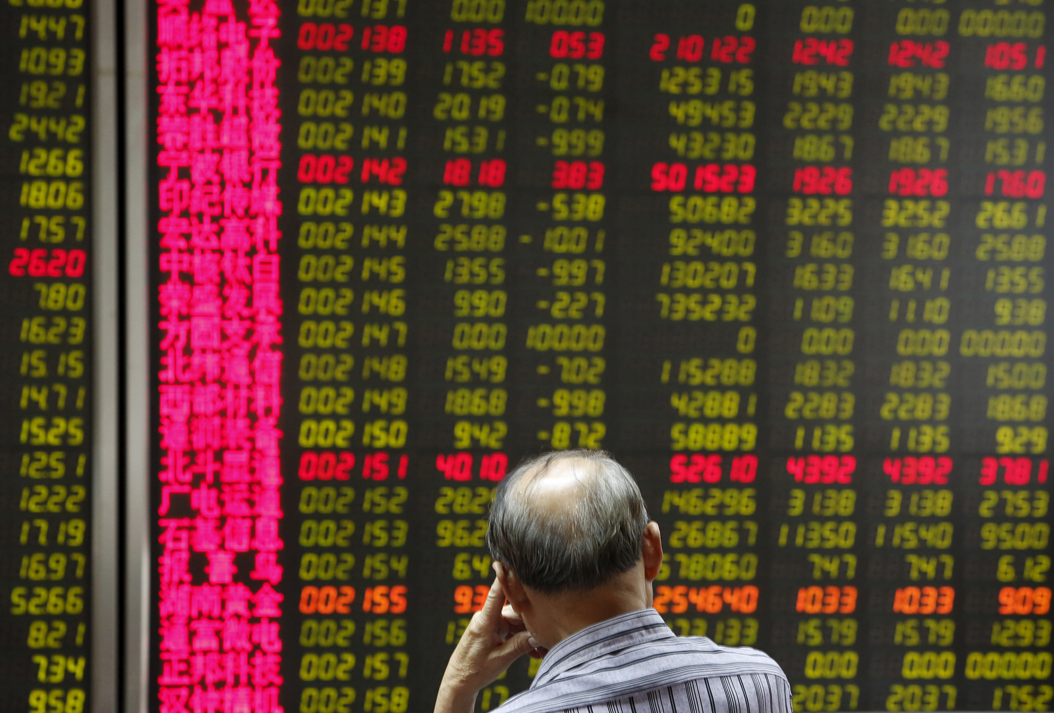 Stock prices at a brokerage office in Beijing, China, July 6, 2015