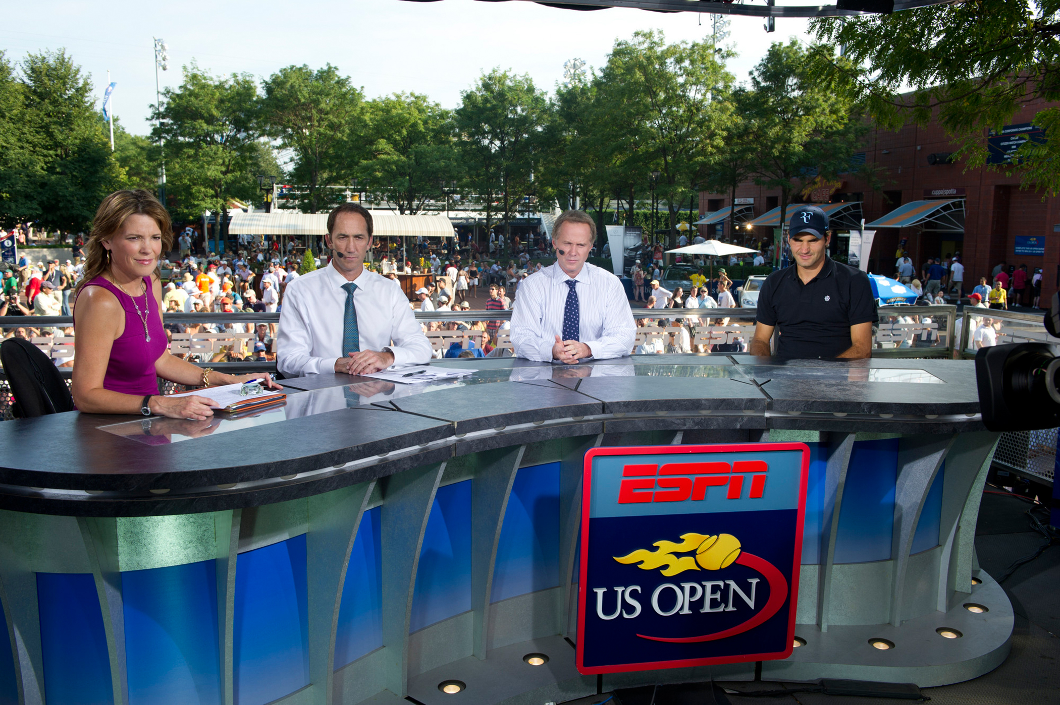 ESPN host Hannah Storm, tennis analysts Darren Cahill and Patrick McEnroe with guest Roger Federer of Switzerland on the on-site set for the US Open Tennis Championships at the USTA Billie Jean King National Tennis Center, 2010.