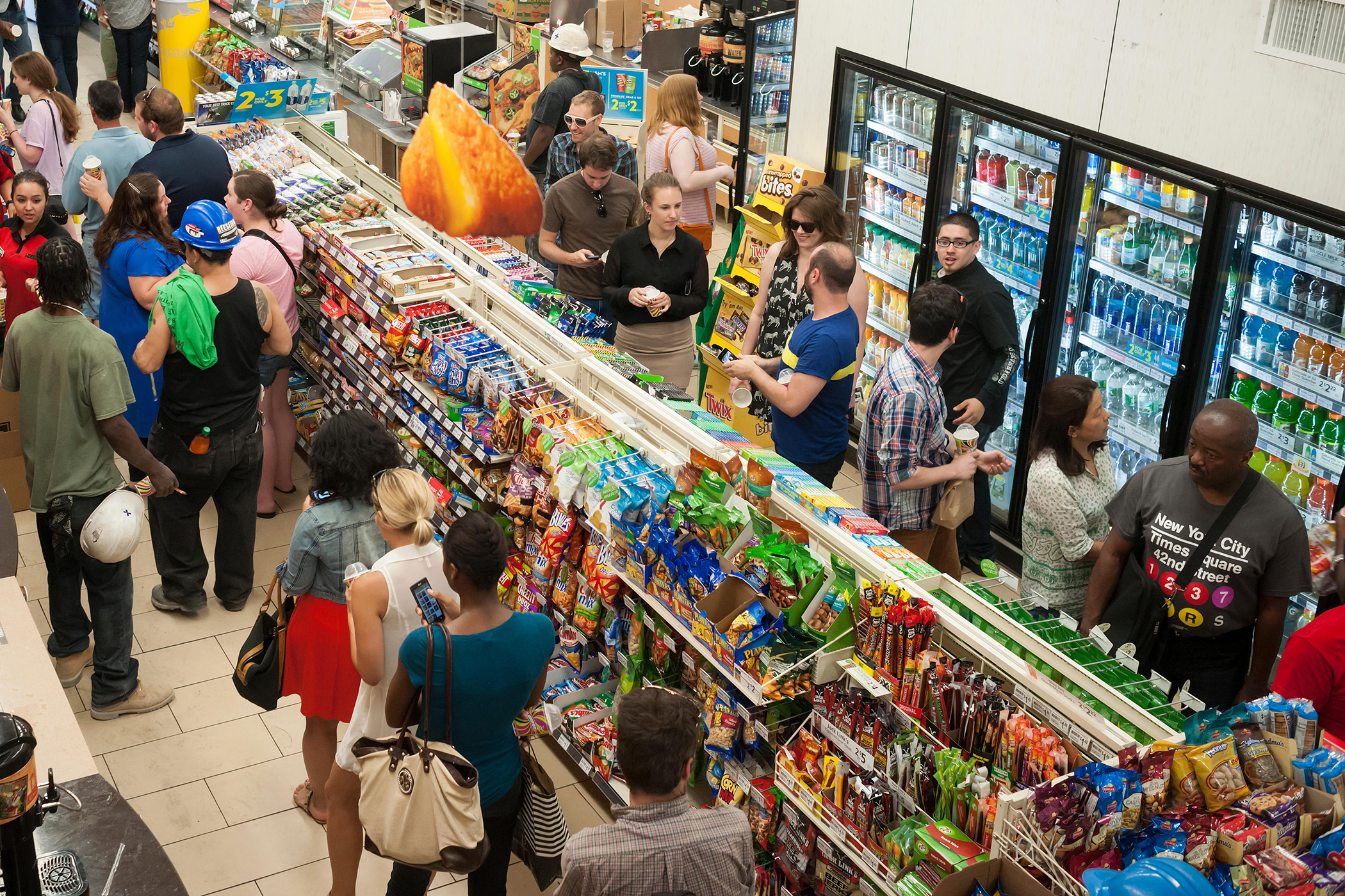 Customers line up for their free Slurpees in a 7-Eleven store in New York