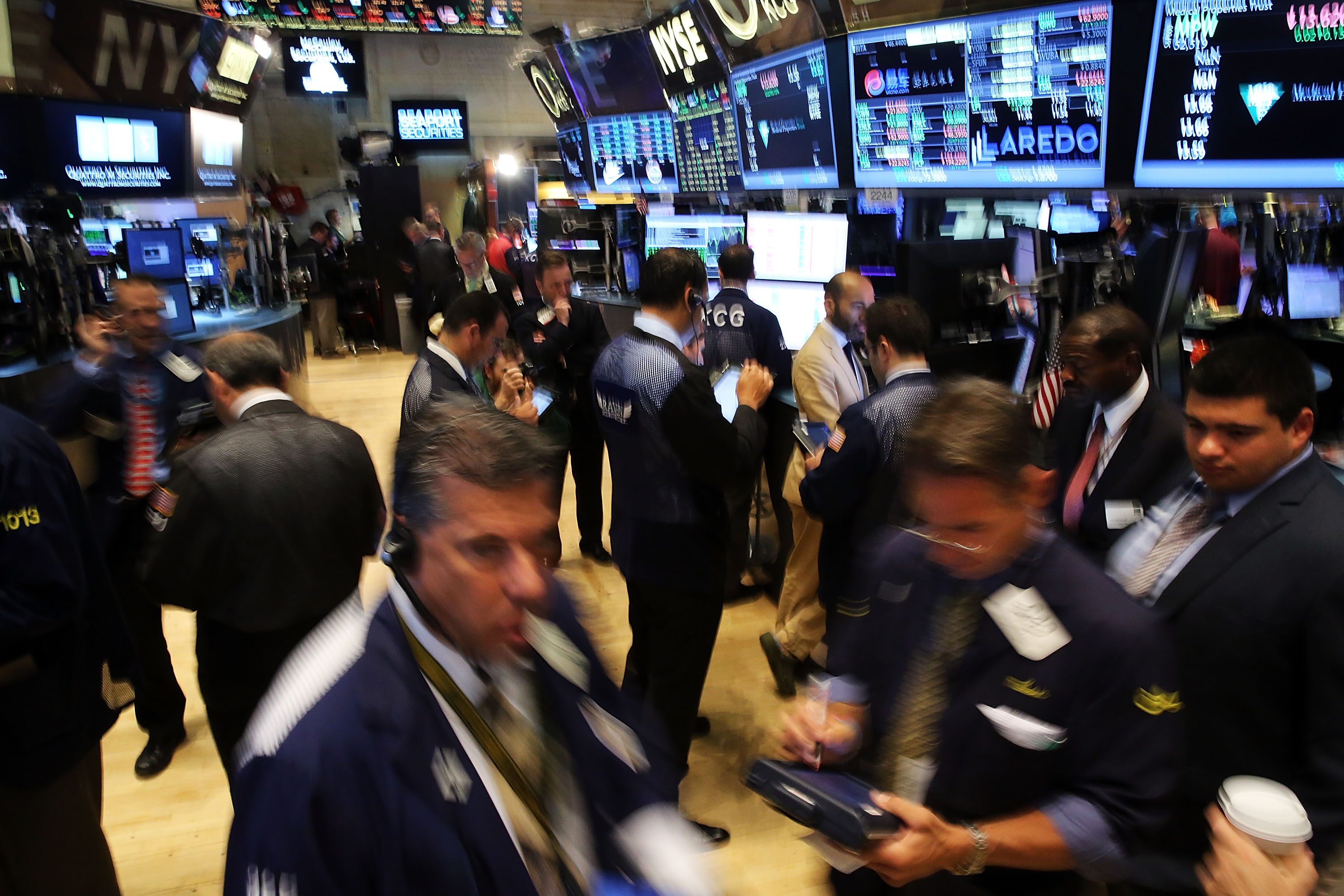 Traders work on the floor of the New York Stock Exchange (NYSE) a day after the market closed for over three hours yesterday due to a  technical glitch  on July 9, 2015 in New York City.