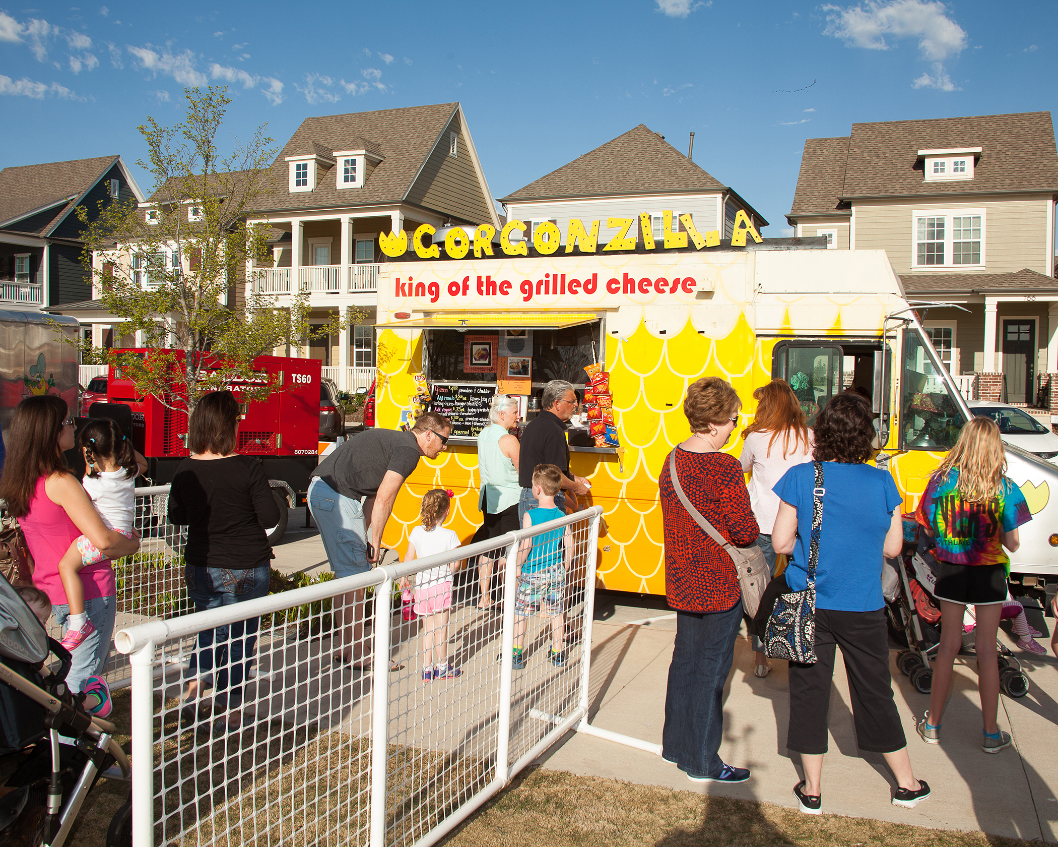 Families enjoy an outdoor dinner at a food truck in Old Town Coppell.