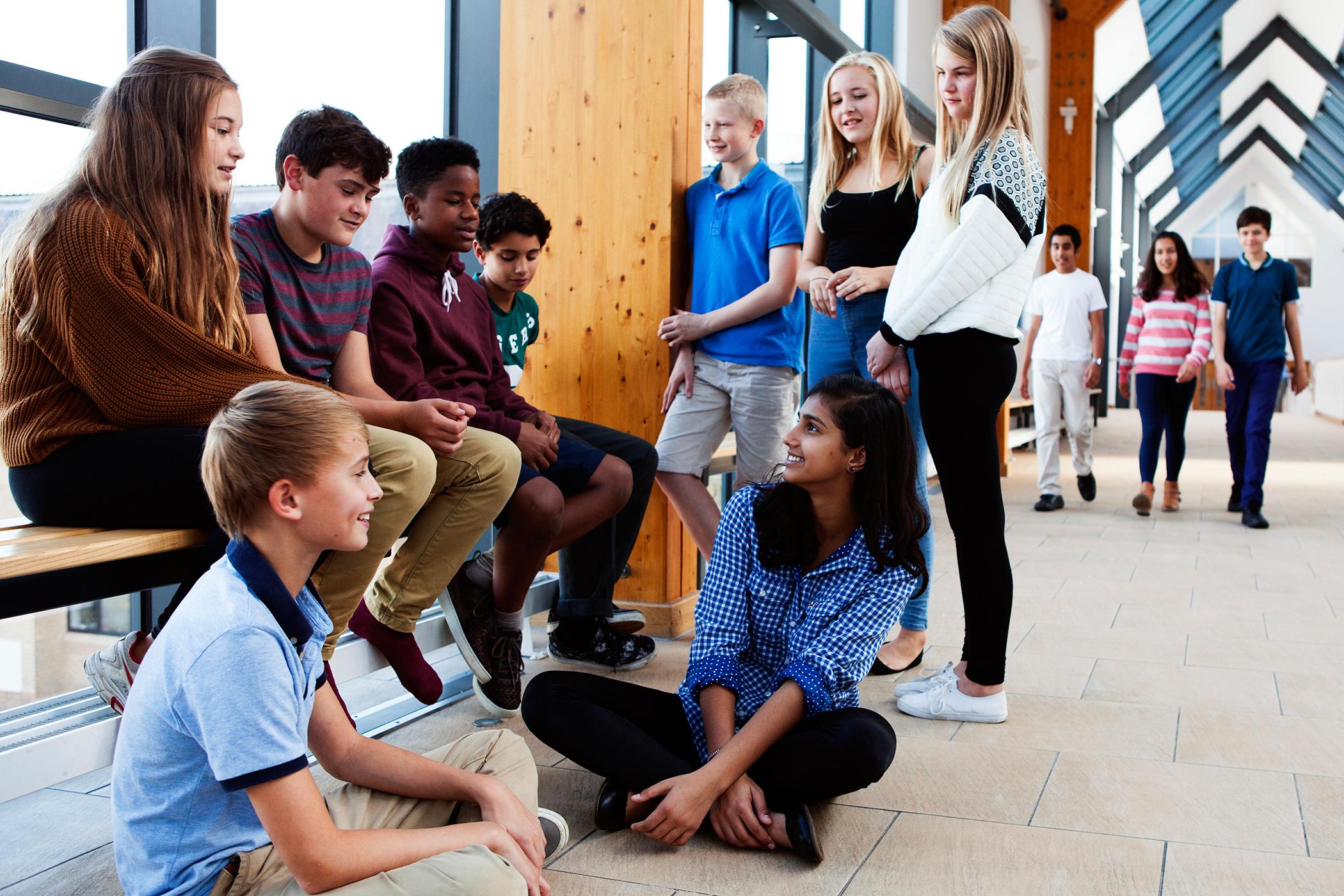 school children chatting in hallway