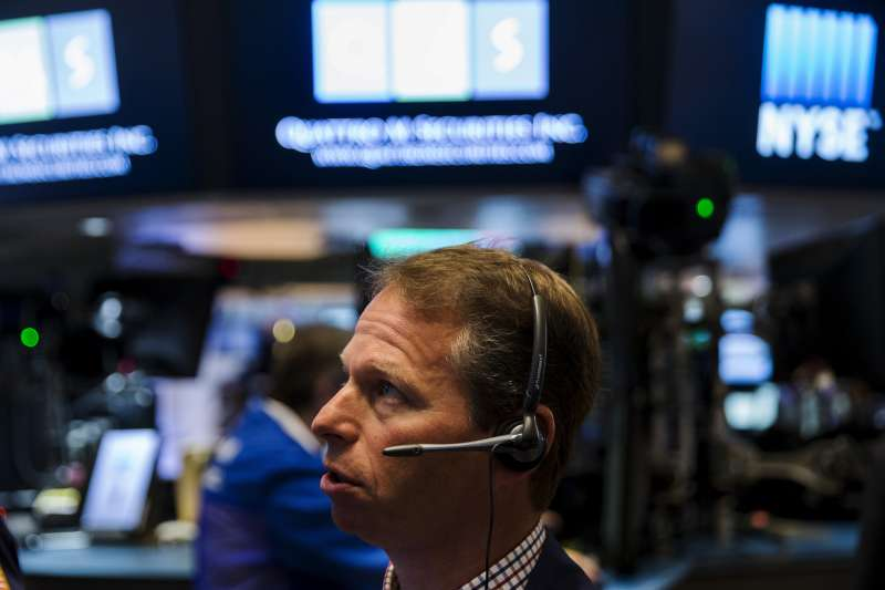 A trader works on the floor of the New York Stock Exchange shortly after the opening bell in New York August 27, 2015.