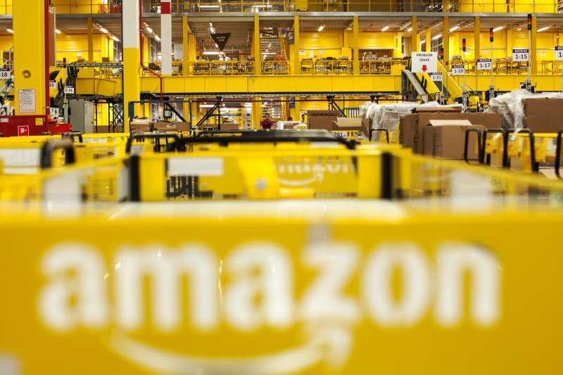 The Amazon logo sits on a cart parked in the inbound goods zone at the Amazon.com Inc. fulfillment center in Poznan, Poland, on Friday, June 12, 2015.