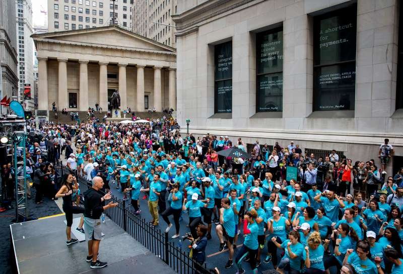 Celebrity fitness trainer Harley Pasternak and actress Jordana Brewster lead a Fitbit lunchtime workout event outside the New York Stock Exchange during the IPO debut of the company on June 18, 2015 in New York City.