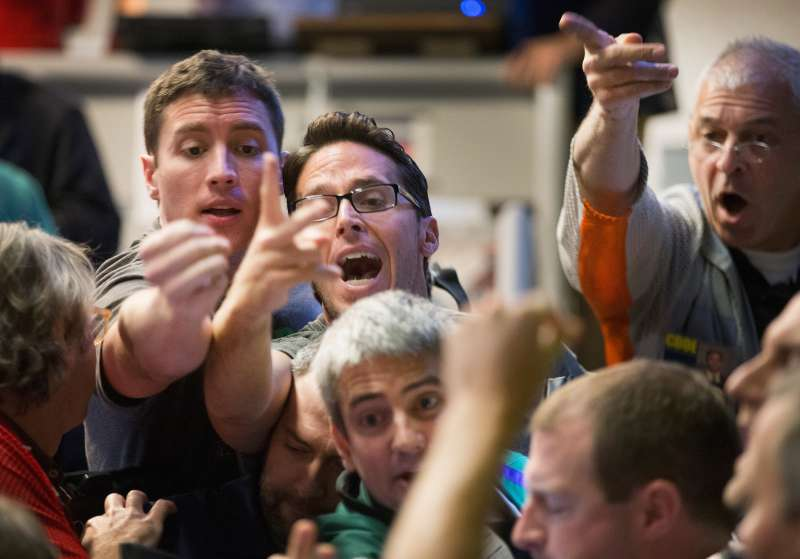 Traders signal offers in the Standard & Poor's 500 stock index options pit at the Chicago Board Options Exchange (CBOE) on August 24, 2015 in Chicago, Illinois. Uncertainty among traders after big losses in the Asian markets caused a sharp drop in the S&P at the open.