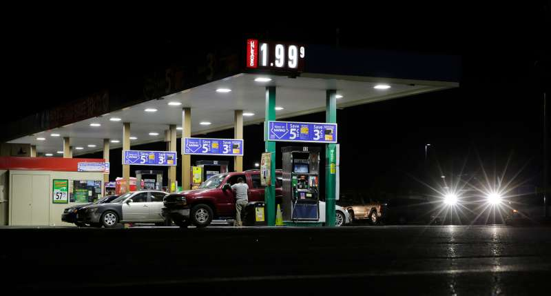 Motorist purchase gas at a station that dropped the unleaded fuel price to $1.99 per gallon, Wednesday, Aug. 26, 2015, in San Antonio.