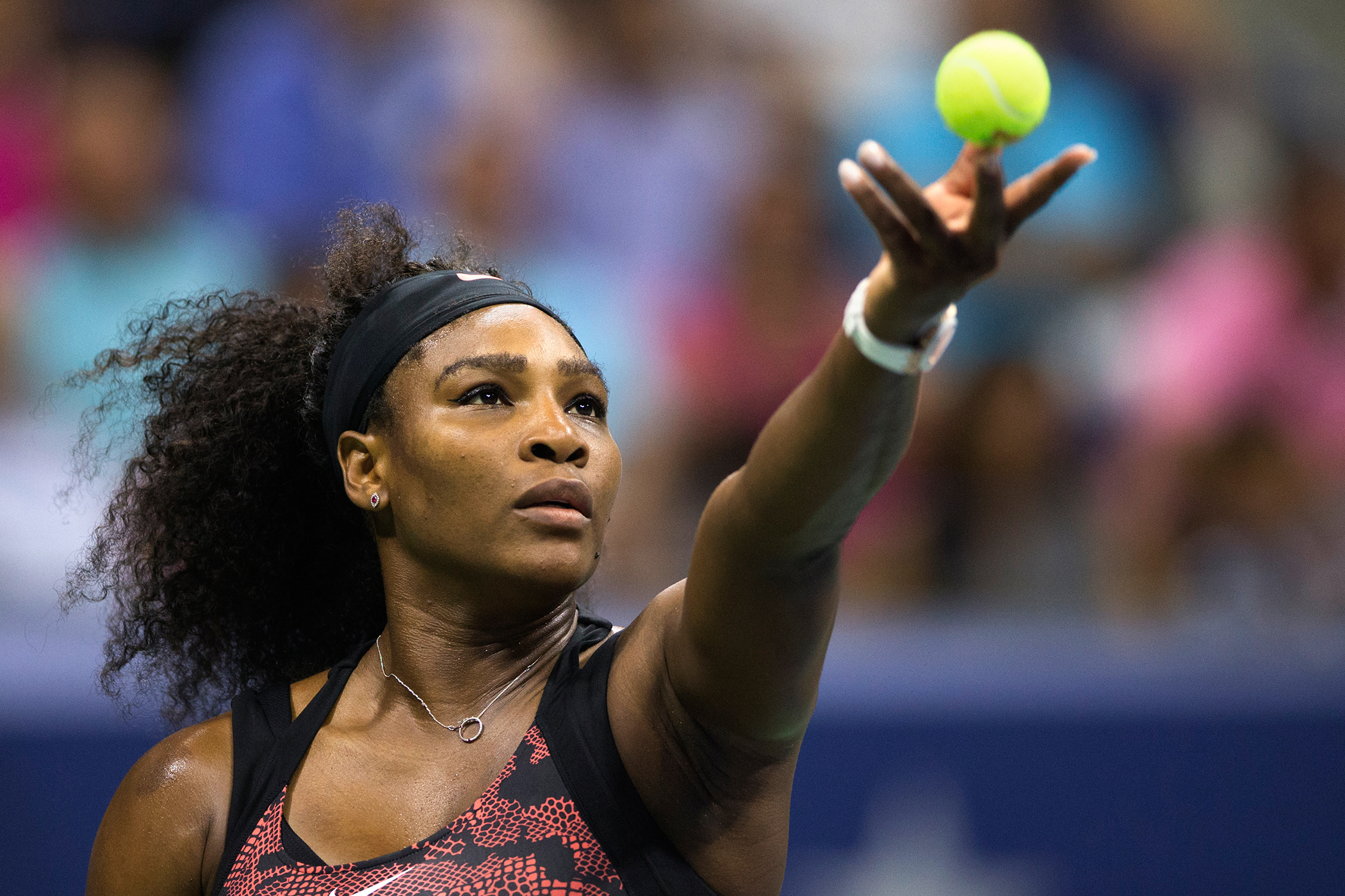 Serena Williams serves to her sister and compatriot Venus Williams during their quarterfinals match at the U.S. Open Championships tennis tournament in New York, September 8, 2015.