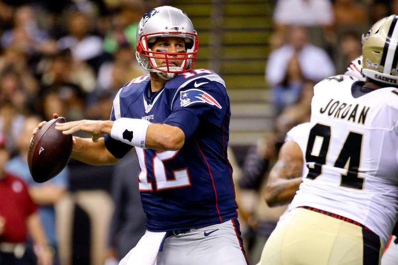 New England Patriots quarterback Tom Brady (12) throws against the New Orleans Saints during the first quarter of a preseason game at the Mercedes-Benz Superdome.