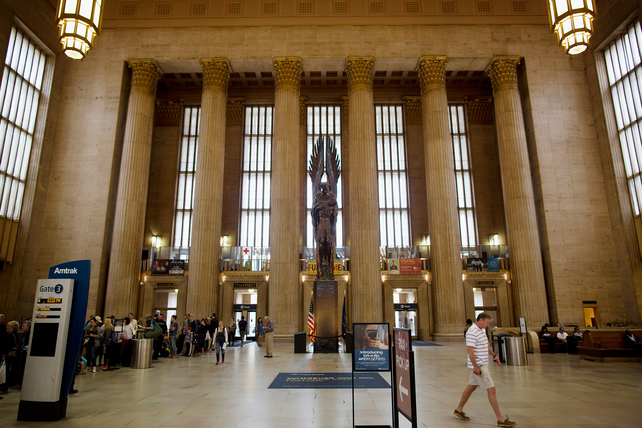 Travelers walk through the 30th Street train station in Philadelphia, Pennsylvania, U.S., on May 9, 2015.