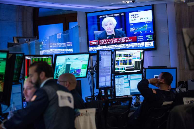 A trader works on the floor of the New York Stock Exchange while Federal Reserve Chairwoman Janet Yellen explains why the Federal Reserve chose not raise interest rates on September 17, 2015 in New York, United States. Traders had speculated for weeks over whether the fed would raise rates or keep them at near zero percent interest.