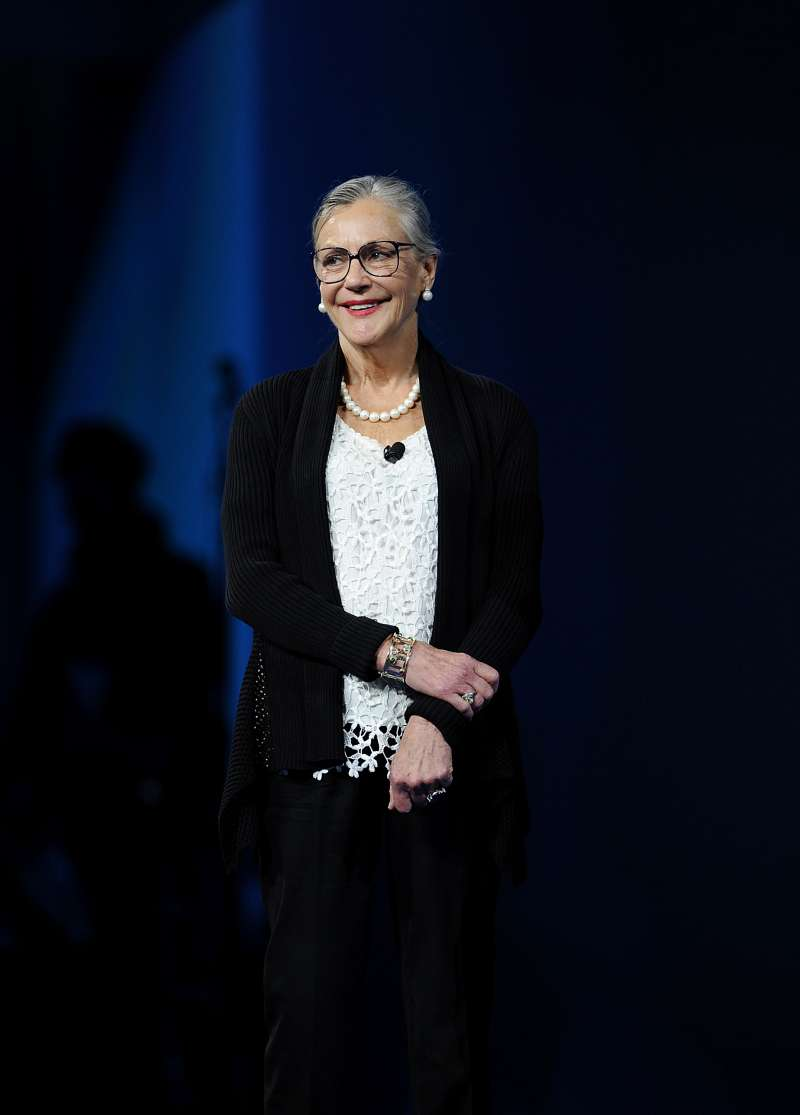 Alice Walton smiles while presenting the Entrepreneur Award during the Wal-Mart Stores Inc. annual shareholders meeting in Fayetteville, Arkansas, U.S., on Friday, June 7, 2013.