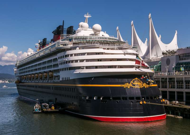 Disney's Wonder cruise ship is dock at Canada Place on June 3, 2013 in Vancouver, British Columbia, Canada. Vancouver is a seaport city with close trading ties to Asia and is the most populous city in Western Canada, with nearly 2.3 million residents in the metropolitan area.