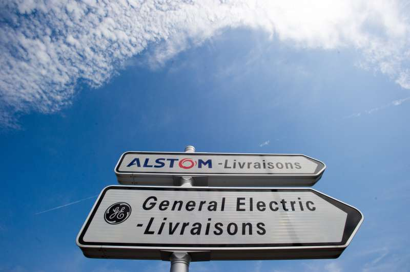 A photo taken on June 23, 2014 in Belfort shows road signs indicating directions for deliveries to French power and transport engineering company Alstom and US conglomerate General Electric (GE).