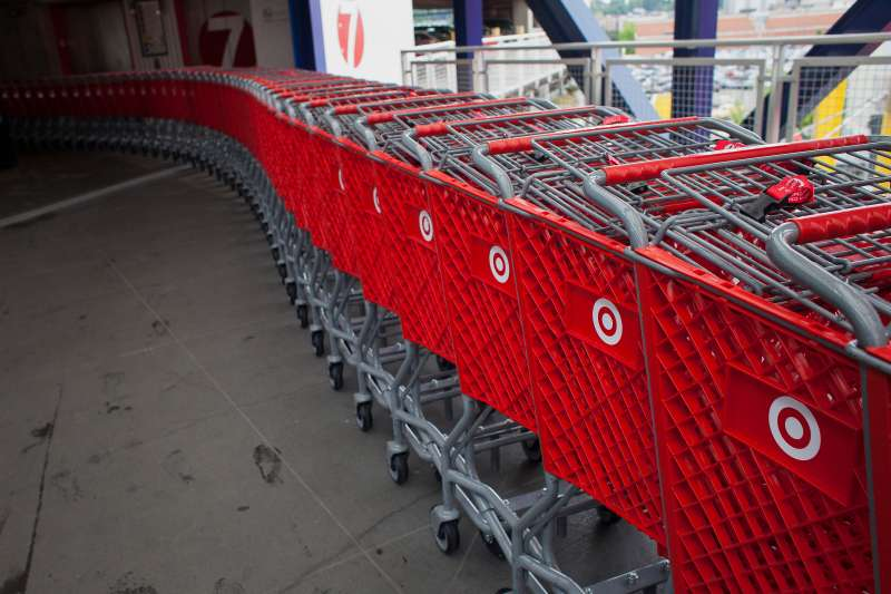 Shopping carts sit lined up at a Target Corp. store in Seattle, Washington, U.S., on Thursday, May 14, 2015.