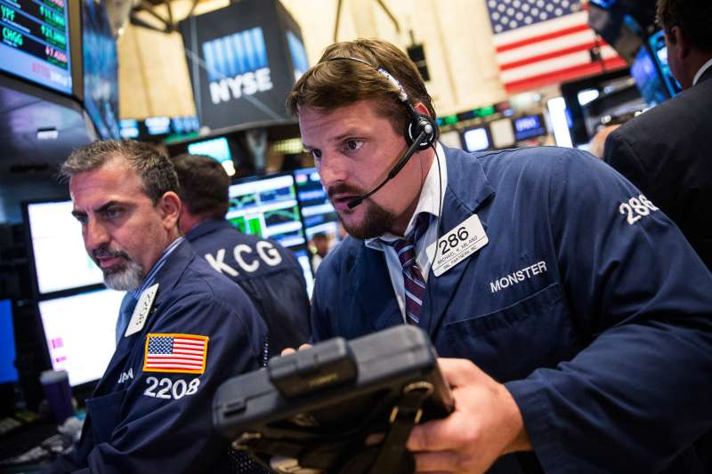 Traders work on the floor of the New York Stock Exchange during the afternoon of September 2, 2015 in New York City. After three days of losses the market closed nearly 300 points up this afternoon.