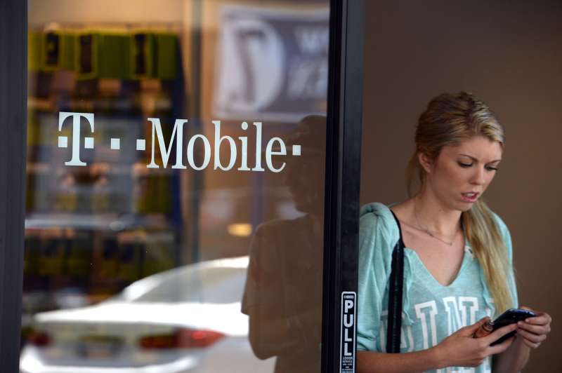 A customer exits a T-Mobile store in Glendale, California, on August 1, 2014.
