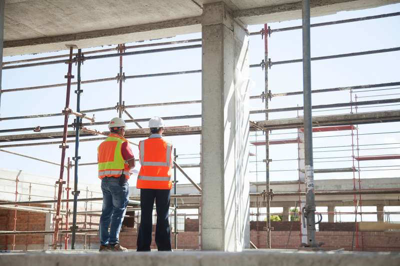Builder and architect on construction site