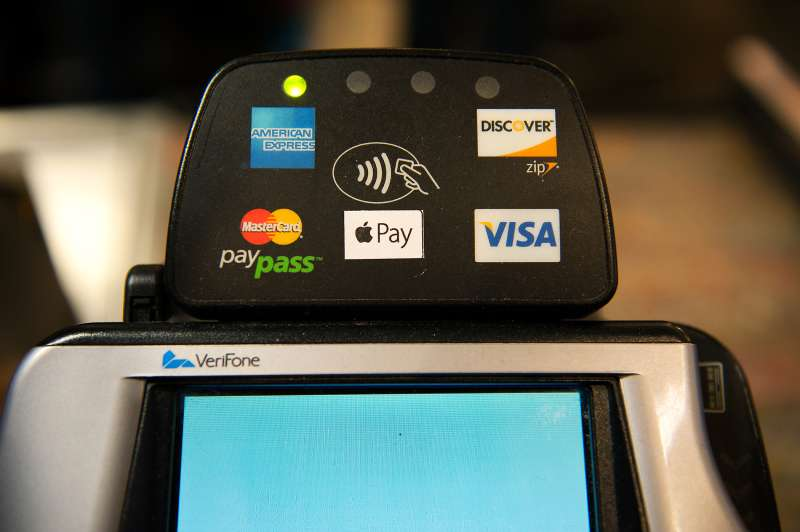 Apple Pay is promoted on signs placed at the cash register of Whole Foods in Columbus Circle on October 20, 2014 in New York, NY.