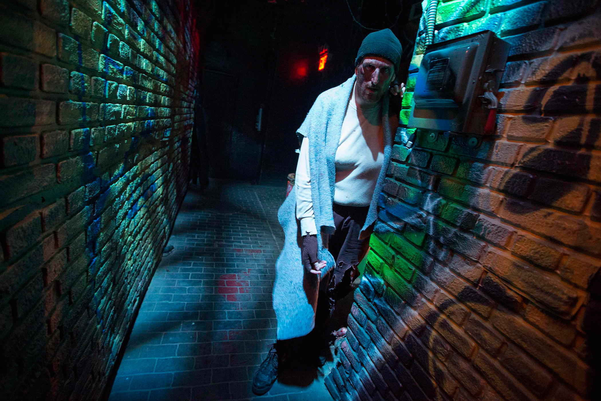 An actor depicting a deranged homeless man living with rats in a New York City alley is seen inside Nightmare: New York, a haunted house for adults, in New York October 22, 2014.