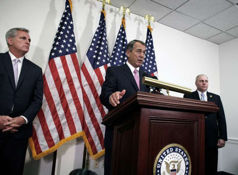 Outgoing House Speaker John Boehner of Ohio, center, flanked by House Majority Leader Kevin McCarthy of California, left, and House Majority Whip Steve Scalise of Louisiana,  talks with reporters on Capitol Hill in Washington, October 27, 2015. House Republican leaders on Tuesday pushed toward a vote on a two-year budget deal despite conservative opposition, relying on the backing of Democrats for the far-reaching pact struck with President Barack Obama.