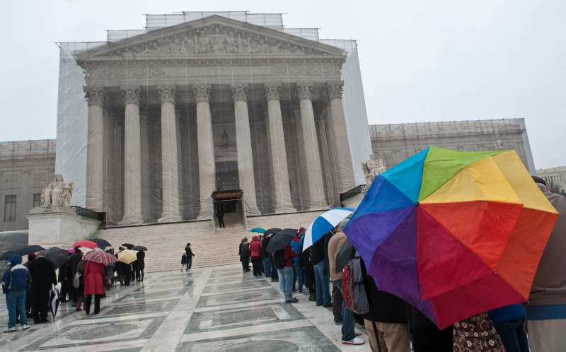 People queue to enter the Supreme Court in Washington on March 25, 2013.