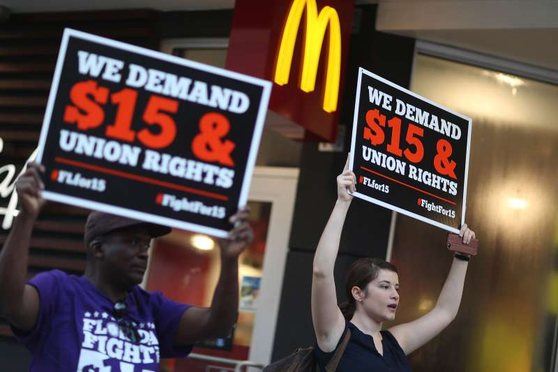 Cecelia O'Brien (R) joins other workers to protest outside a McDonald's restaurant on November 10, 2015 in Miami, Florida. The protesters are demanding action from state legislators and presidential candidates to raise the minimum wage to $15 an hour.