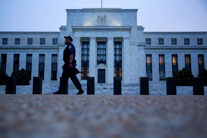 A Federal Reserve police officer walks past the Marriner S. Eccles Federal Reserve building in Washington, D.C., on September 2, 2015.