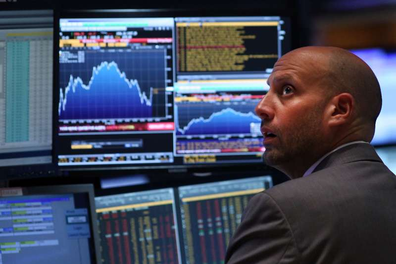 A trader works on the floor of the New York Stock Exchange (NYSE) on August 24, 2015 in New York City. The Dow Jones industrial average briefly dropped over 1000 points in morning trading and closed down 588 points.
