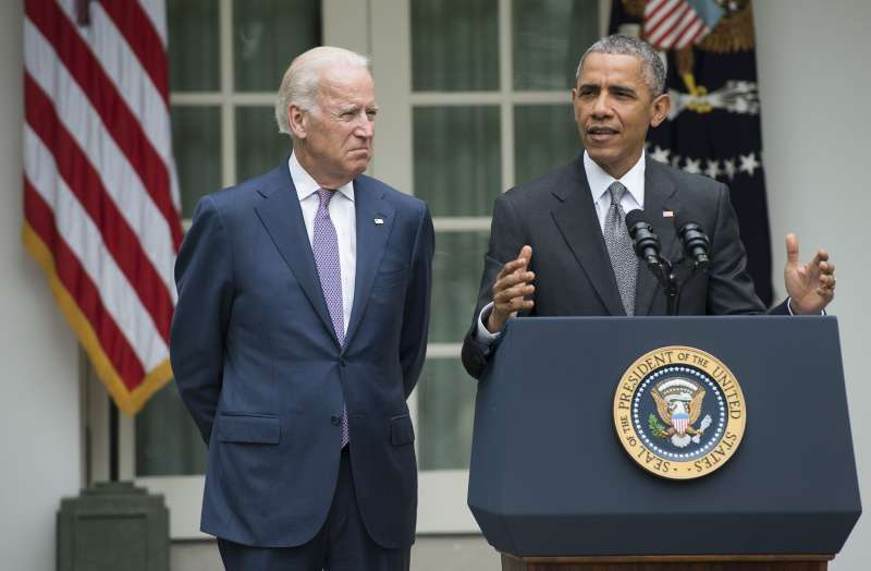 US President Barack Obama speaks alongside US Vice President Joe Biden about the Supreme Court's ruling to uphold the subsidies that comprise the Affordable Care Act, known as Obamacare, in the Rose Garden of the White House in Washington, DC, June 25, 2015.