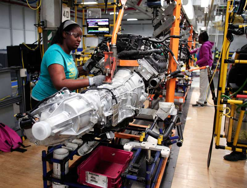 A transmission for a Chrysler Ram 1500 truck goes through the assembly line at the Warren Truck Assembly Plant in Warren, Mich., in Sept. 2014.