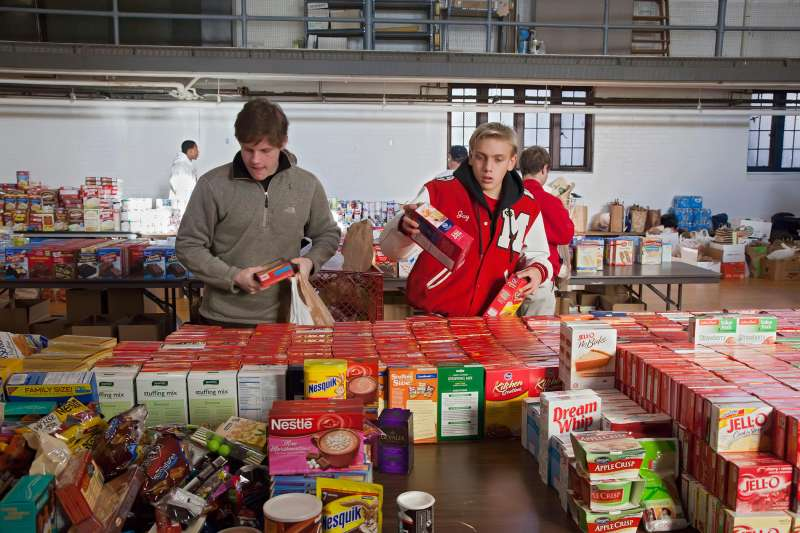 Volunteers from Orchard Lake St. Mary's, a Catholic boys school in Pontiac, Michigan, sort donated food which will be distributed to low-income families for Thanksgiving, November 18, 2011. The annual food distribution is organized by Lighthouse of Oakland County, a social services agency.