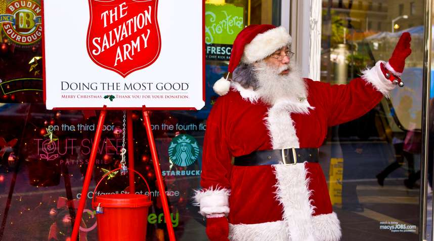 A Santa Claus rings a bell for The Salvation Army in front of Macy's in Union Square in San Francisco, California.