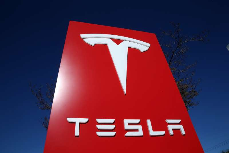 A sign is posted at a Tesla showroom in Palo Alto, California.