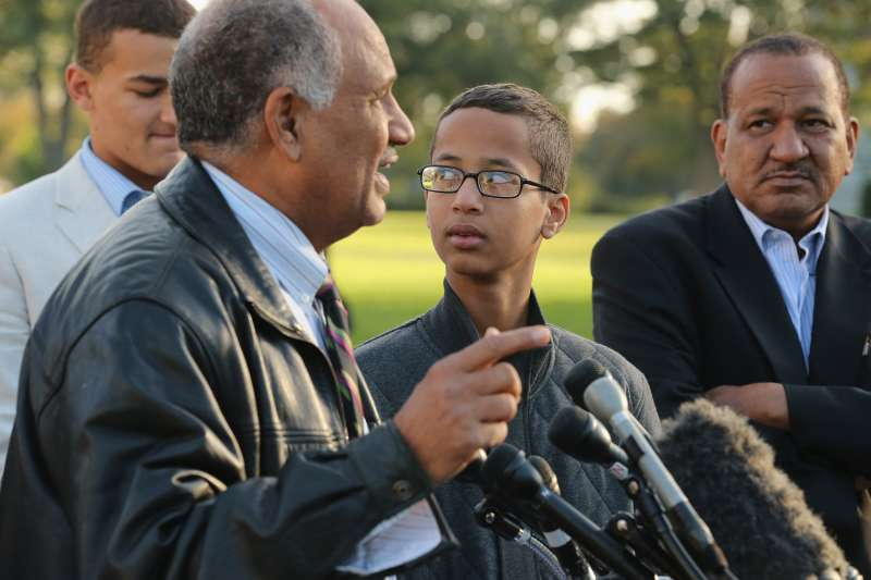 Fourteen-year-old Ahmed Mohamed (C) of Irving, TX, his cousin Mohammed Elhassan (L) and uncle Aldean Mohamed listens to Ahmed's father and former Sudanese presidential candidate Mohamed Elhassan.