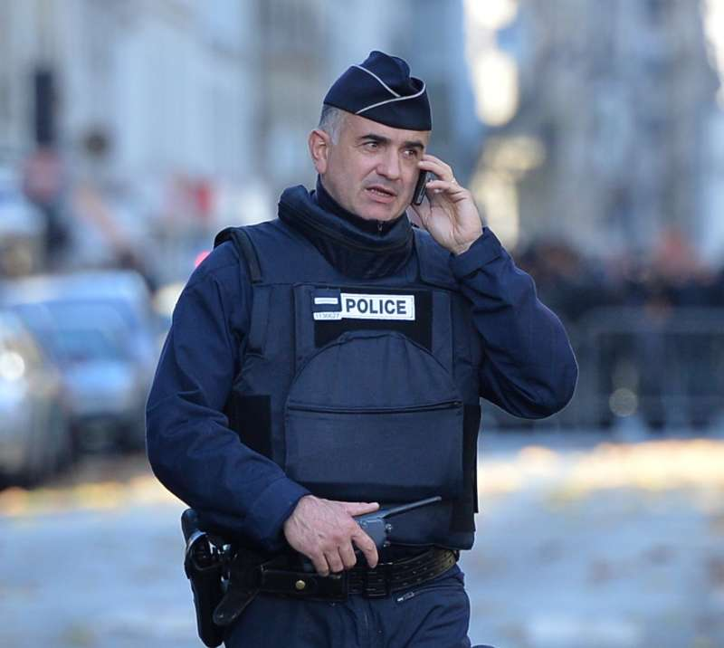 French police officer is seen as having a phone conversation in front of Notre Dame in Paris following the terrorist attack.