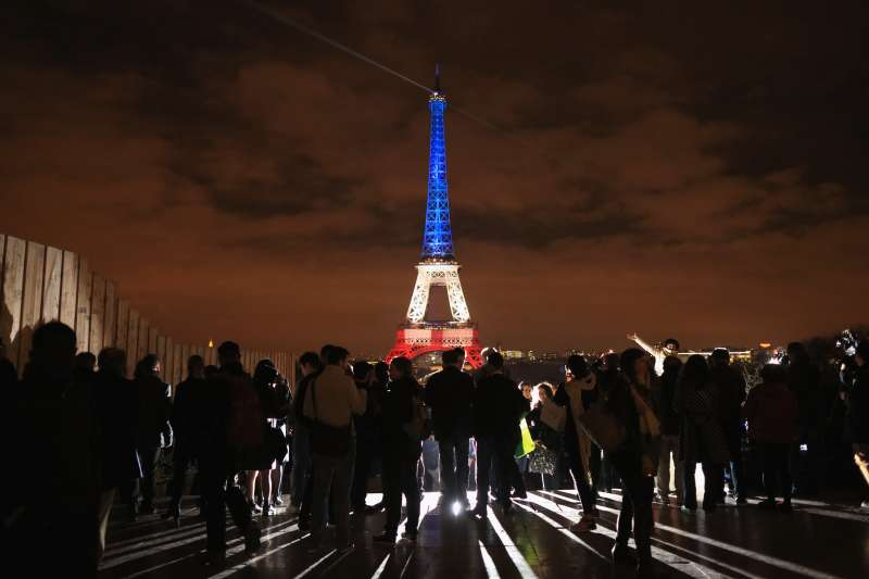 The Eiffel Tower is illuminated in Red, White and Blue in honor of the victims of Friday's terrorist attacks