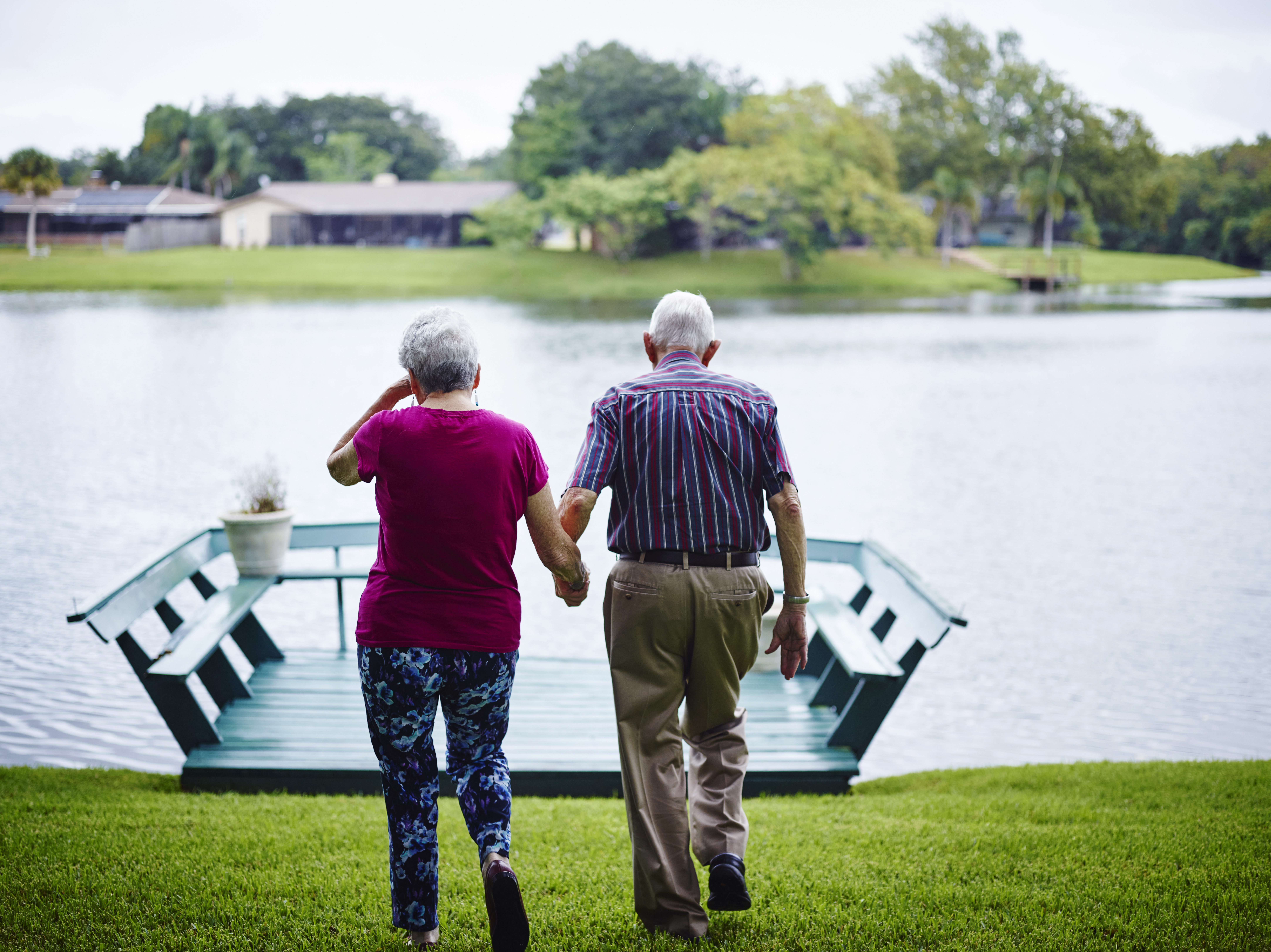 Dick Pell looks after his wife, Helen, at their Sarasota home.