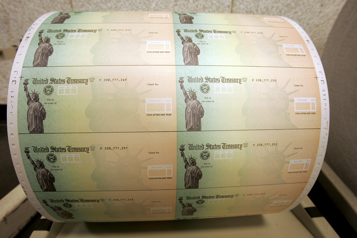 Blank U.S. Treasury checks are seen on a roll at the Philadelphia Financial Center, which disburses payments on behalf of federal agencies.