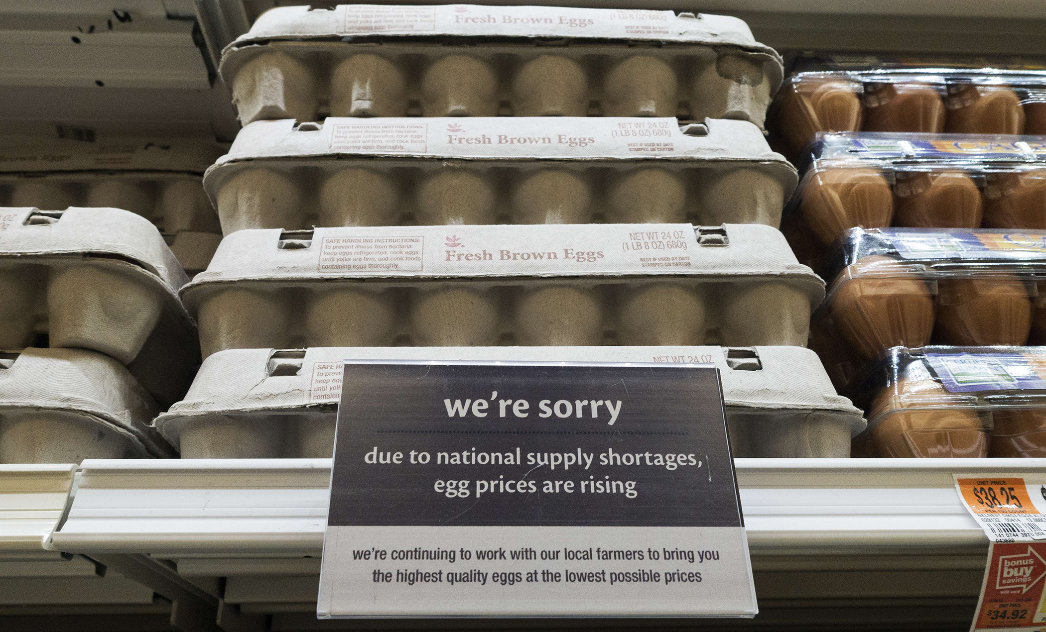 A notice that the price of eggs will be rising soon is seen on June 4, 2015, at a Giant grocery store in Clifton, Virginia.