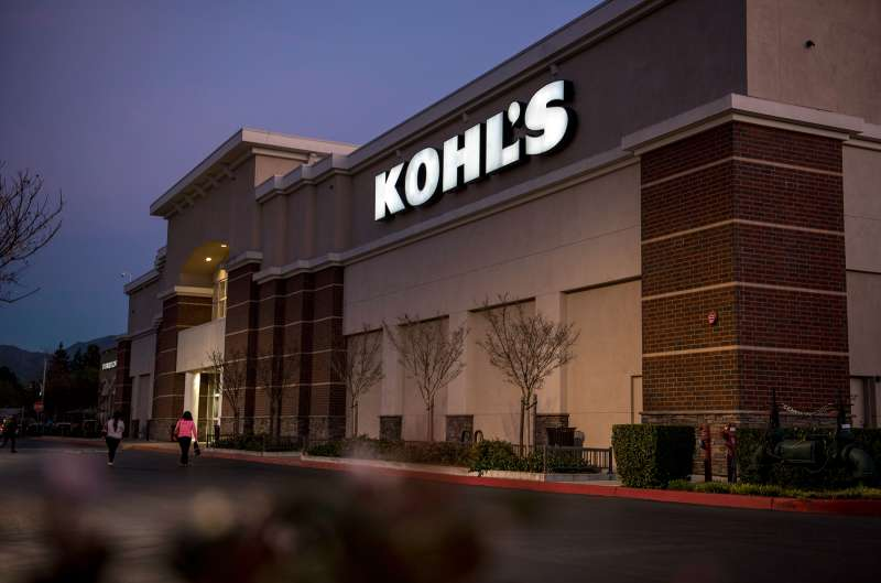 Pedestrians walk in front of a Kohl's store in Concord, California., on February 24, 2015.