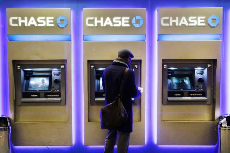 A customer uses an ATM at a branch of Chase Bank in New York.