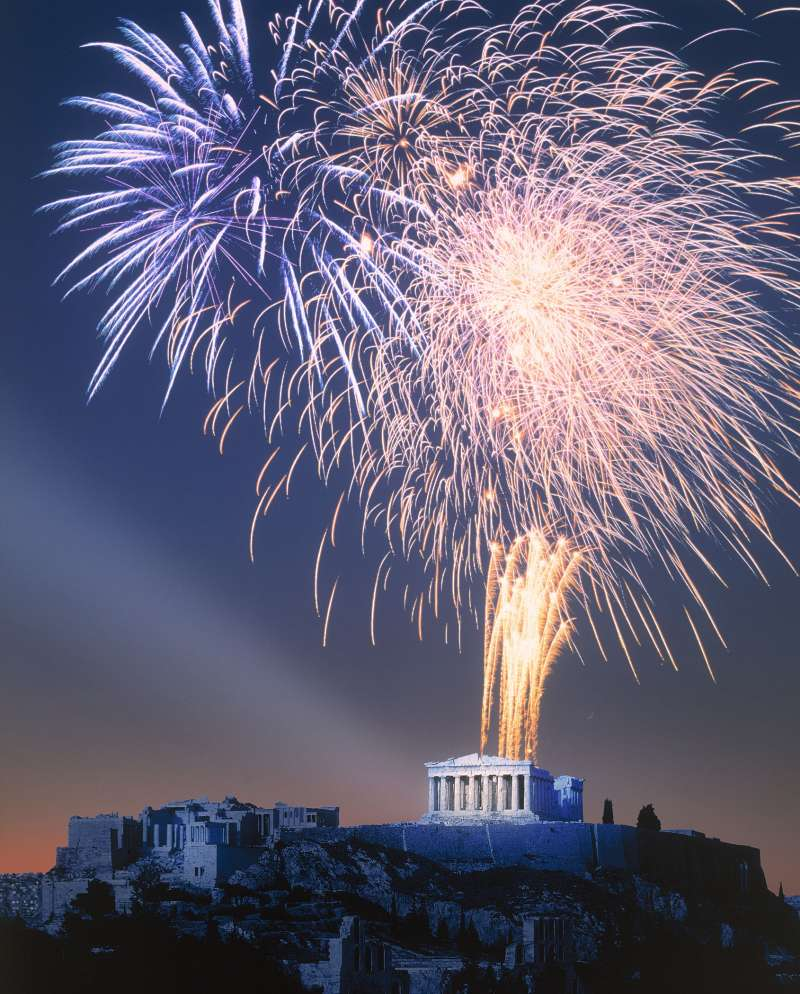 Fireworks burst over the ancient temple of Parthenon on Acropolis hill in Athens.