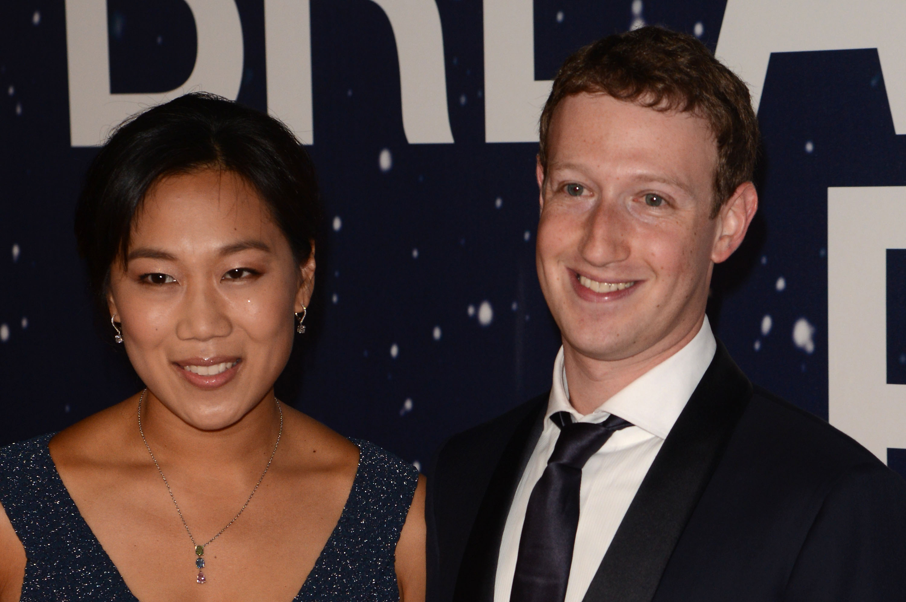 Priscilla Chan and Mark Zuckerberg attend the 2014 Breakthrough Prize Awards at NASA AMES Research Center on November 9, 2014 in Mountain View, California.