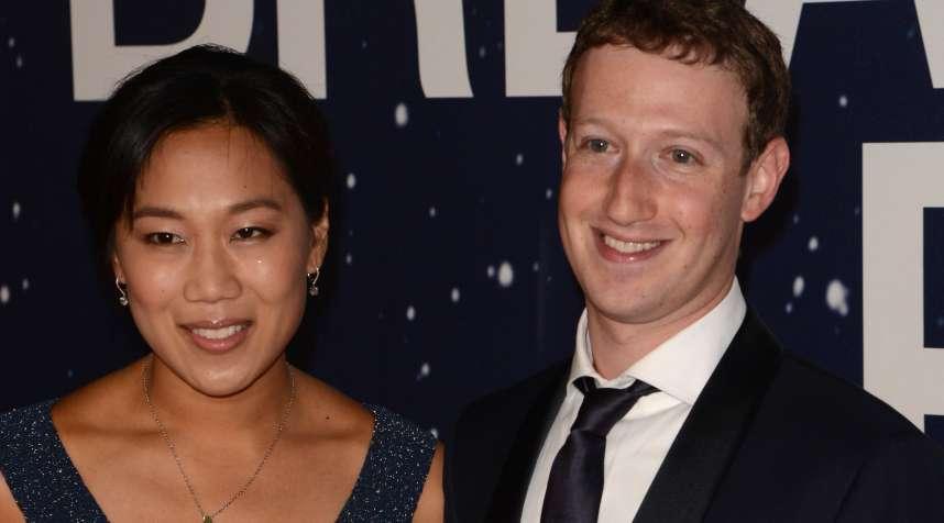 Priscilla Chan and Mark Zuckerberg attend the 2014 Breakthrough Prize Awards at NASA AMES Research Center on November 9, 2014 in Mountain View, California.