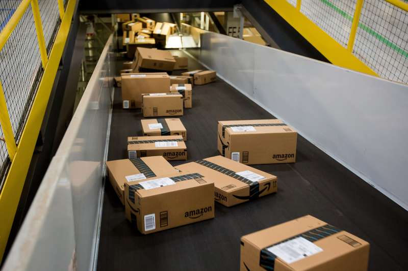 Boxes move along a conveyor belt at the Amazon.com Inc. fulfillment center in Robbinsville, New Jersey, U.S.